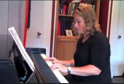 Jennifer Savitch plays two beginner songs.