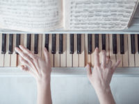Hands_on_piano_keys